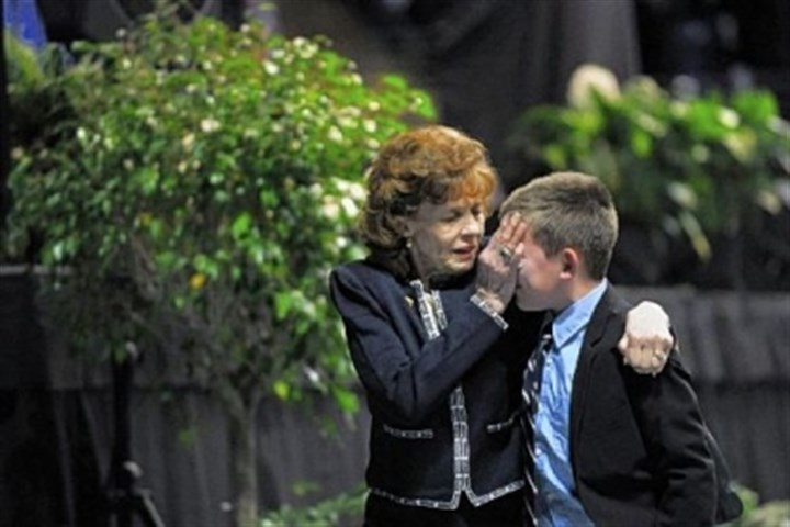 "Sue Paterno Sue Paterno wipes tears from the face of one of her grandchildren as they leave ""A Memorial for Joe"" last January at the Bryce Jordan Center on the campus of Penn State University."