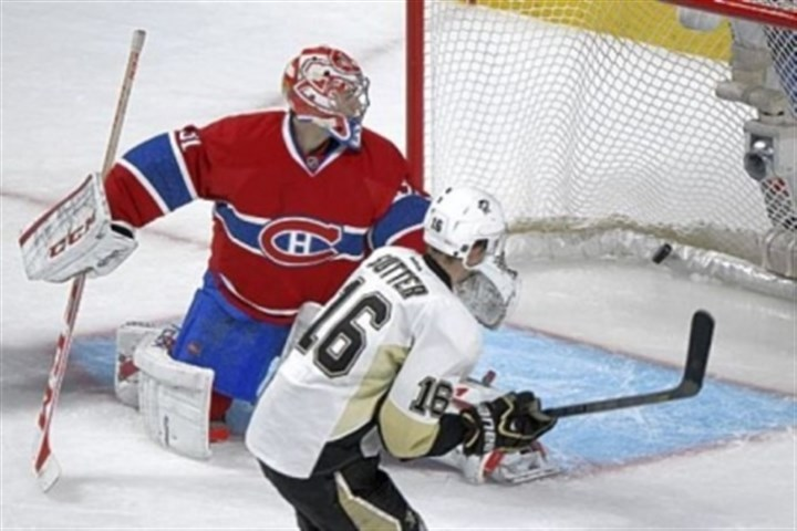 Sutter Montreal goaltender Carey Price is scored on by the Penguins' Brandon Sutter in an overtime.