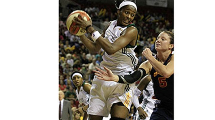 Swin Cash Seattle Storm's Swin Cash, left, grabs a rebound during a WNBA basketball game in 2011.