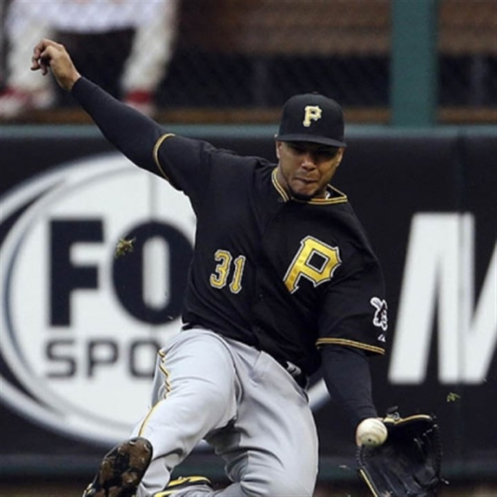 tabata Pirates right fielder Jose Tabata makes a sliding catch of a ball hit by St. Louis' Carlos Beltran in the third inning Saturday at Busch Stadium.