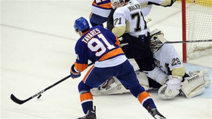 John Tavares The Islanders' John Tavares reaches to score on Penguins goaltender Marc-Andre Fleury in the third period.