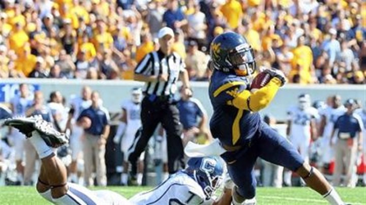 Tavon Austin West Virginia's dazzling receiver Tavon Austin, seen here gaining yardage against Connecticut, is helping young and undersized Jordan Thompson follow in his footsteps.