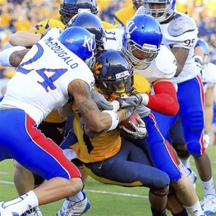 TavonAustin.jpg Kansas' Bradley McDougald (24) and Ben Heeney (31) tackle Tavon Austin in the first quarter.