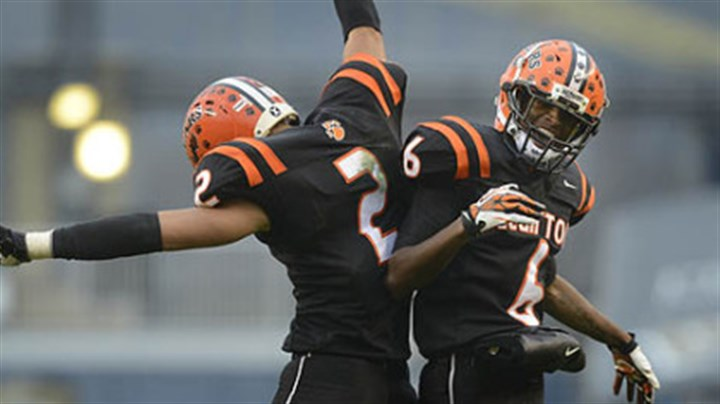 TD jump Clairton Bears Santeaun Sims (left) and Titus Howard celebrate Coles touchdown Friday at Heinz Field. The Bears set a Pennsylvania record with its 60th consecutive victory, a 58-21 win against Sto-Rox in the WPIAL Class A title game.