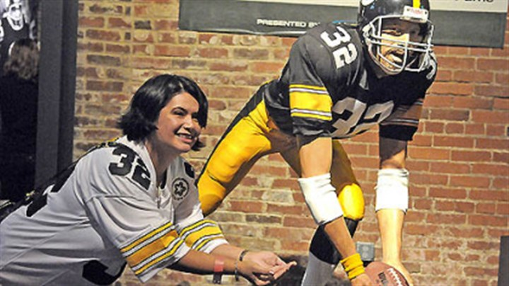 Tess Barker Tess Barker from Iowa City poses for a photograph with the Franco Harris Immaculate Reception statue at the Heinz History Center following today's session celebrating the 40th anniversary of the event.