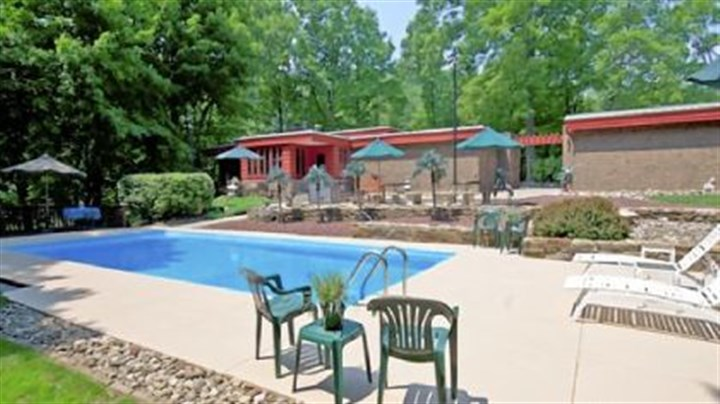 The 36- by 14-foot pool was repainted last year. The 2.29-acre property at Merrie Woode Drive includes two large pressure-treated wood decks near the 10-foot deep concrete pool. The 36- by 14-foot pool was repainted last year.