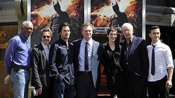 "'The Dark Knight Rises' cast ""The Dark Knight Rises"" director Christopher Nolan, fourth from left, poses Saturday with cast members at his hand and footprint ceremony at Grauman's Chinese Theatre in Los Angeles."