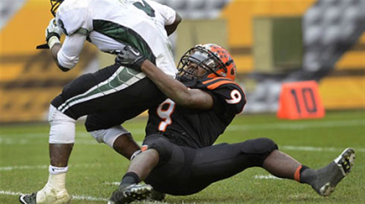 The sack Clairton Bear Robert Boatright takes down Sto-Rox quarterback Lenny Williams Friday at Heinz Field.