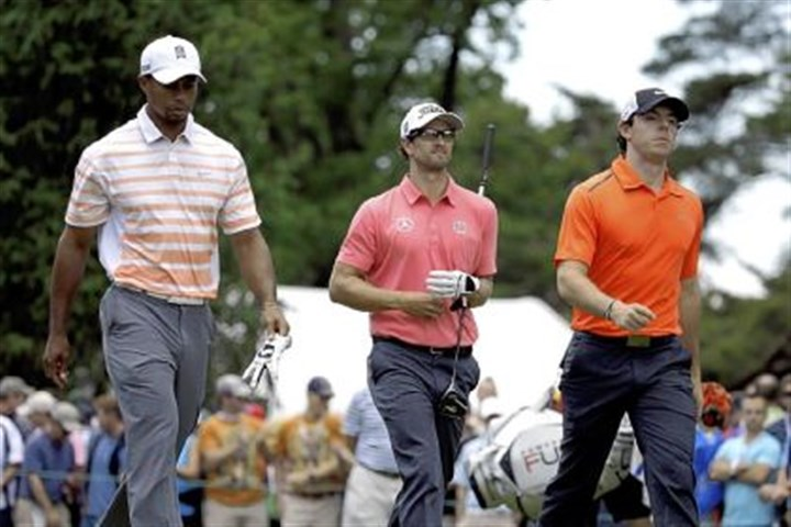 tiger The world's top 3 players From left, Tiger Woods, Adam Scott and Rory McIlroy walk down from the fourth tee box Friday during the second round of the U.S. Open at Merion Golf Club in Ardmore, Pa.