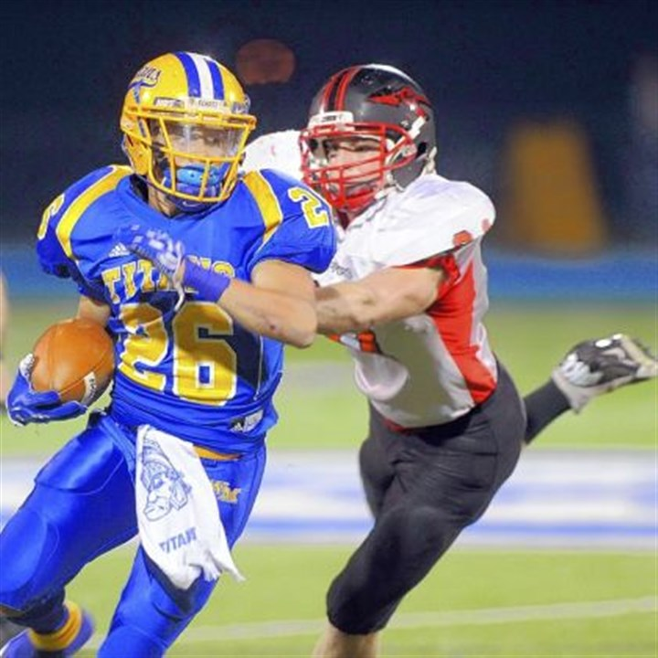 Titans West Mifflin's Jimmy Wheeler, sweeping right end during a game last year against Elizabeth Forward, finished the 2012 season with the third best rushing total of all WPIAL running backs, piling up 2,226 yards on 289 carries.