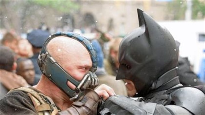 "Tom Hardy and Christian Bale As Bane, Tom Hardy goes head to head with Christian Bale's Batman in this summer's ""The Dark Knight Rises."""
