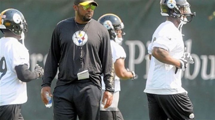 tomlin Steelers coach Mike Tomlin watches organized team activities through his trademark aviator sunglasses Thursday at the team's South Side facilities.