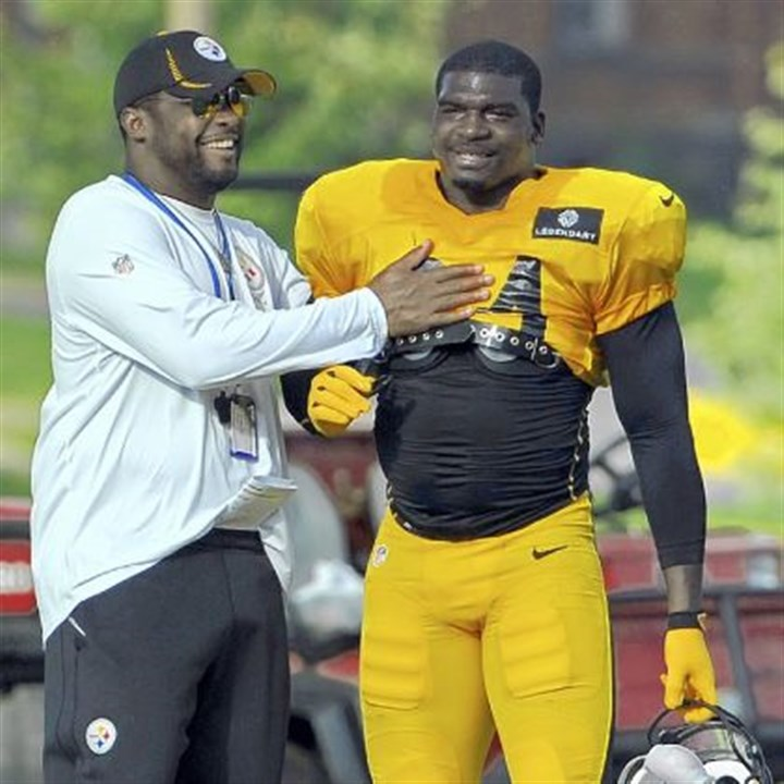 tomlin Steelers coach Mike Tomlin talks with veteran linebacker Lawrence Timmons at training camp.