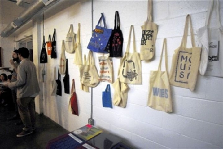 Tote bags Tote bags from other art shows are used as decor.