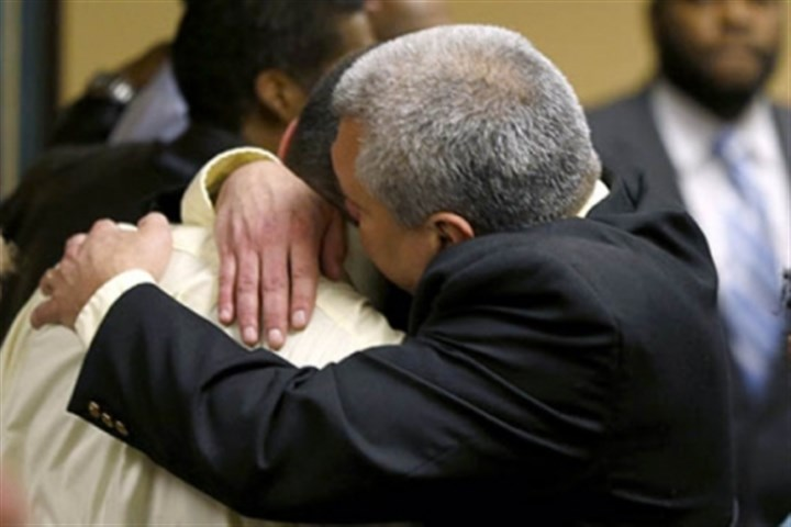 Trent Mays and father Trent Mays, 17, left, gets a hug from his father. Trent and co-defendant Malik Richmond, 16, were found delinquent for rape.