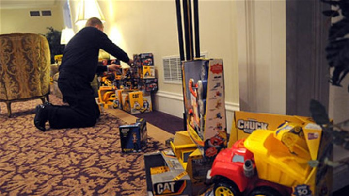 trucks at funeral home More trucks are added to the collection at Slater Funeral Home in Green Tree, where people donated the toys in memory of two-year-old Maddox Derkosh.