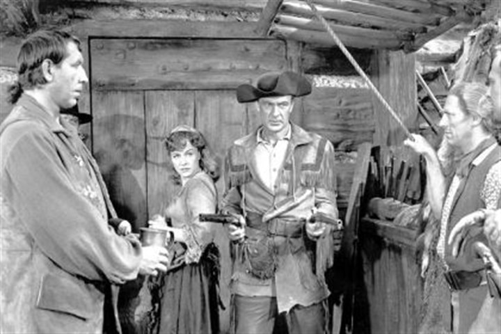 "'Unconquered' Gary Cooper protects Paulette Goddard in Cecil B. DeMille's ""Unconquered,"" a movie about pre-revolutionary days around Fort Pitt. Two pistols used by Cooper and owned by DeMille will be on display at the Fort Pitt Museum."