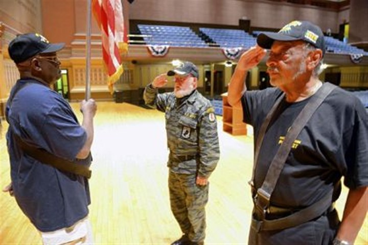 Vigil John Martin of Portersville, center, who served in the Army in Vietnam, changes the post of William Jenkins of Monroeville, left, (Army in Germany), and David Lanier, right, of Penn Hills (Air Force in Vietnam) as they stood vigil at Soldiers & Sailors Memorial Hall and Museum Saturday.