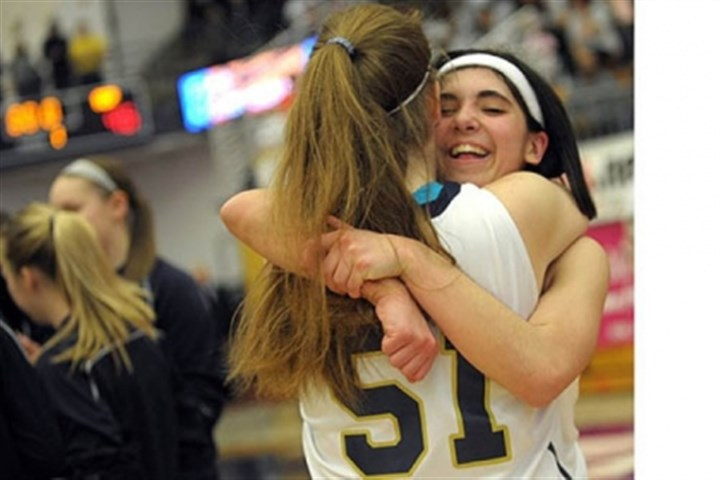 Vincentian Vincentian teammates celebrate after beating Serra Catholic for the Class A girls title.