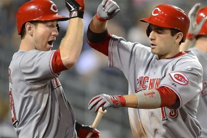 votto The Reds' Joey Votto is greeted at home by Todd Frazier after hitting the winning home run in the 10th inning.