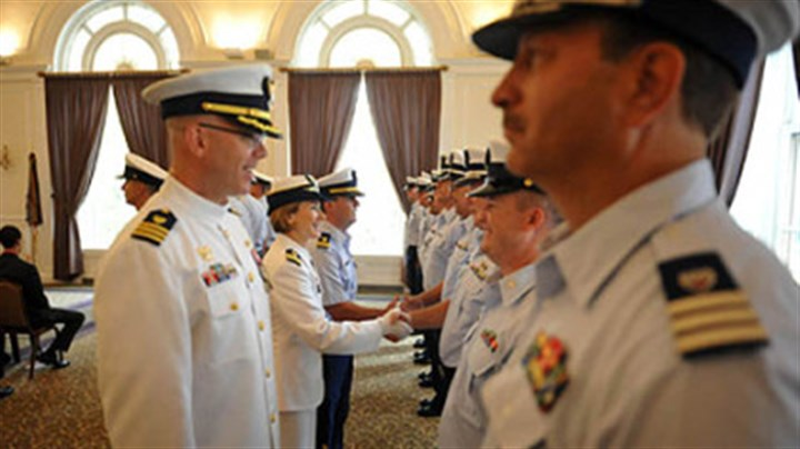 Weaver greets coast guard Incoming Commander Lindsay Weaver, center, shakes hands with members of her unit.