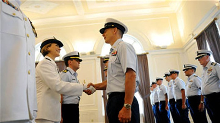 weaver greets new command Incoming Commander Lindsay Weaver, left, shakes hands with members of her unit during a traditional inspection of personnel during a US Coast Guard MSU Change of Command Ceremony held at the University Club in Oakland on Friday, July 13, 2012. Weaver will be the first female commanding officer of the US Coast Guard MSU in Pittsburgh.