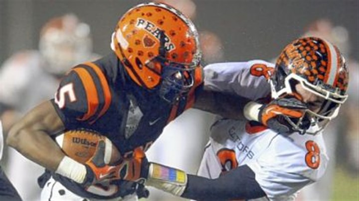 webb Clairton?s Terrish Webb pushes away Port Allegany?s Matt Bodamer as he carries in the PIAA semifinal Friday night.