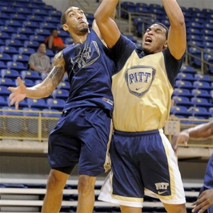 wright Cameron Wright blocks Derrick Randall's shot in the Blue-Gold Scrimmage Sunday at Petersen Events Center.