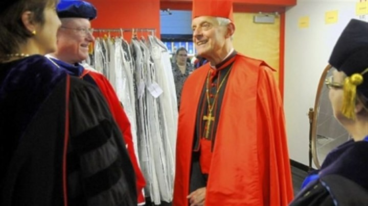 Wuerl Duquesne University president Charles J. Dougherty, left, speaks with Cardinal Donald Wuerl, archbishop of Washington, D.C., the commencement speaker, before ceremonies Friday at the A.J. Palumbo Center. At far left is Marie Milie-Jones, chairman of the board of directors, and far right is Linda Drago, a Duquesne University vice president.