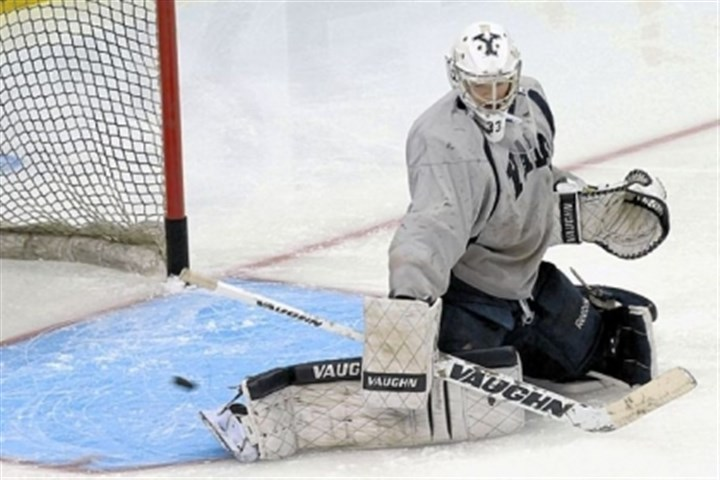 yale Yale goalie Jeff Malcolm deflects a puck during practice Friday at Consol Energy Center.