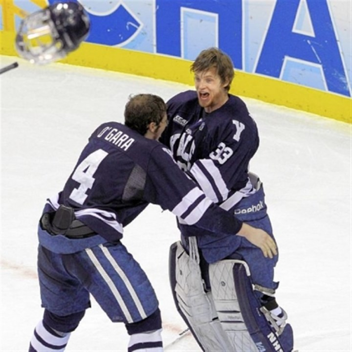 yale Yale's Rob O'Gara, left, celebrates at the horn with winning goaltender Jeff Malcolm.
