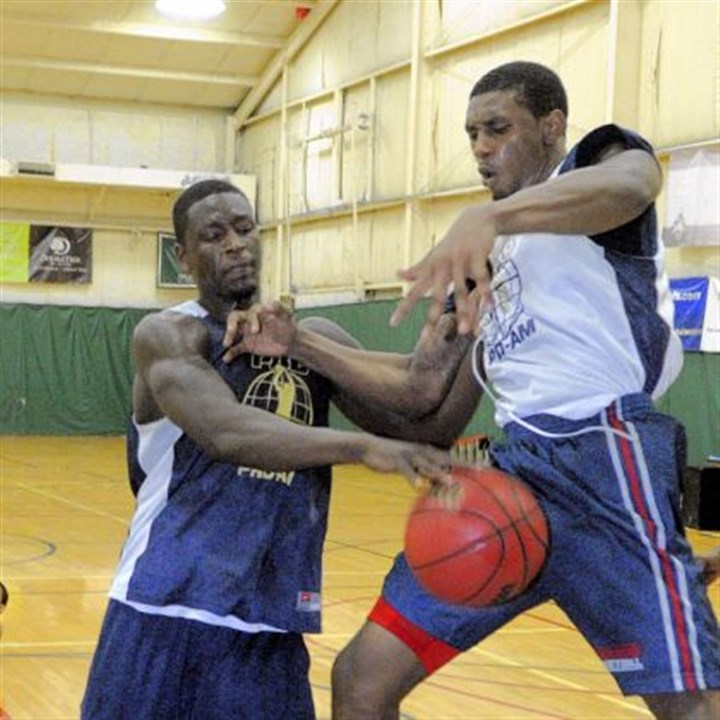 zanna2 Talib Zanna of PGT Trucking, left, fights for a rebound against Ovie Soko of The Lair in the 2013 Pittsburgh Pro-Am basketball finals held The Greentree SportsPlex.