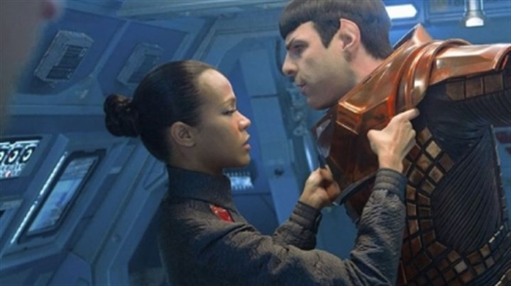 Zoe Saldana and Zachary Quinto Zoe Saldana is Uhura and Zachary Quinto is Spock in 'Star Trek Into Darkness.'