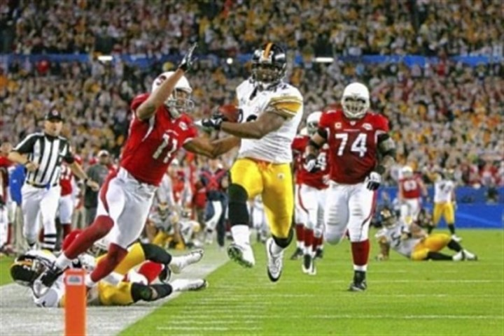 James Harrison James Harrison scores a touchdown after running back an interception for 100 yards in the second quarter against the Arizona Cardinals during Super Bowl XLIII on February 1, 2009 at Raymond James Stadium in Tampa, Florida.