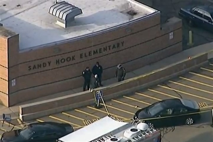 Sandy Hook Police Police outside Sandy Hook school in Newtown, Conn., in 2012.