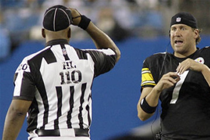 nflref0810 Steelers quarterback Ben Roethlisberger talks to an NFL official.