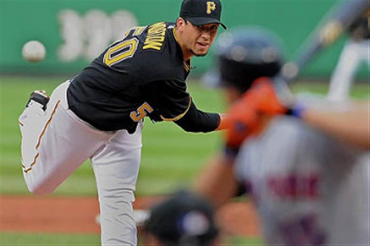 Charlie Morton Pirates pitcher Charlie Morton delivers a pitch to the Mets' Carlos Beltran at PNC Park.