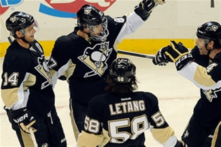 015.jpg Penguins center Sidney Crosby is congratulated by teammates after scoring a goal.