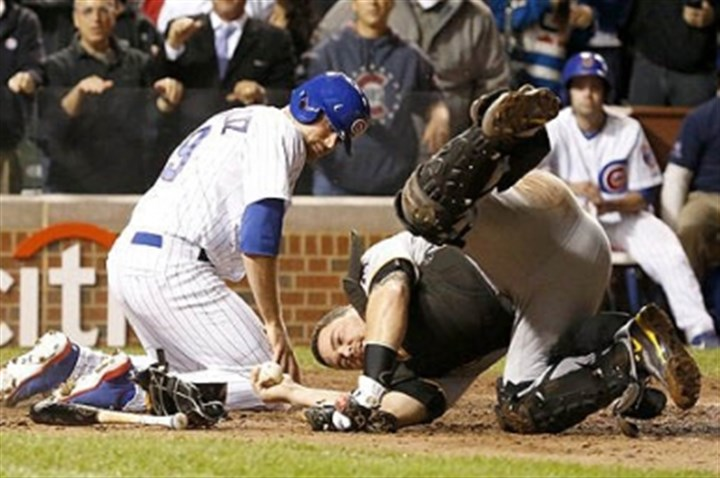martin New rules aim to make home plate collisions, like this one last year betweeen Pirates catcher Russell Martin and Chicago's Nate Schierholtzm, safer.