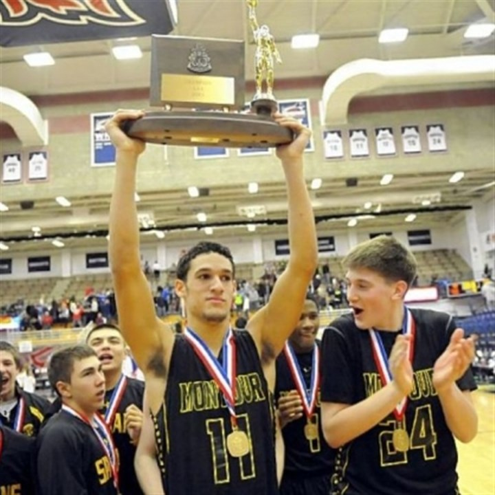 Montour's Devin Wilson Montour's Devin Wilson holds the trophy after defeating Chartiers Valley in the 2013 WPIAL Class AAA championship.