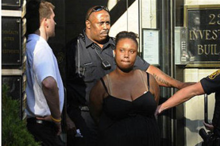 Breona Moore Police take Breona Moore of East McKeesport into custody on August 23.
