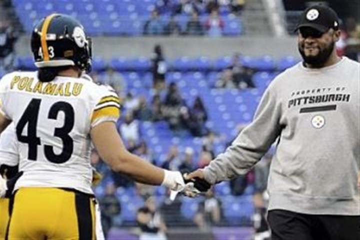 polamalu and tomlin Steelers head coach Mike Tomlin greets Troy Polamalu during warmups before the game against the Ravens in Baltimore.