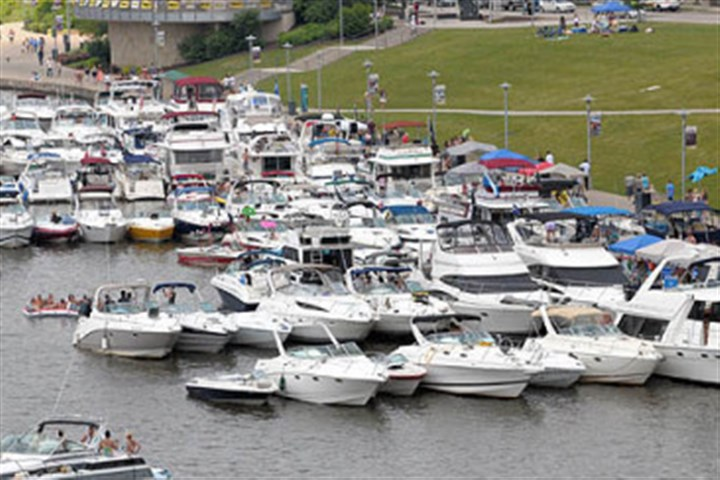 Chesney fans Country singer Kenny Chesney's fans moor their boats along the North Shore as they await an evening concert at Heinz Field last summer.