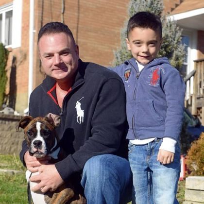 Pet Tales Joey Deiuliis with his son Gavin, 6, and Bowser, their 6-month-old boxer.