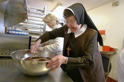 Sister Rose Marie Tumicki Sister Rose Marie Tumicki mixes a batch of Ruby Jubilee Brownies at Our Lady of the Sacred Heart High School in Moon.
