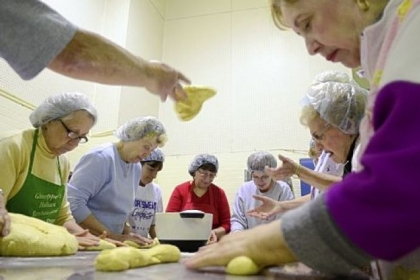 Volunteers from Holy Redeemer Parish Volunteers from Holy Redeemer Parish in Ellwood City come together to roll dough that will be baked into Easter bread.
