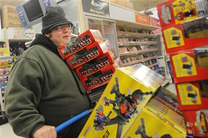 20131128rldShoppingLOCAL03-3 Benjamin Davis of Sharpsburg stocks up on Transformers and Power Rangers toys that he plans to resell on Thursday, November 28, 2013. The Toys R Us store in Monroeville opened at 5 p.m.
