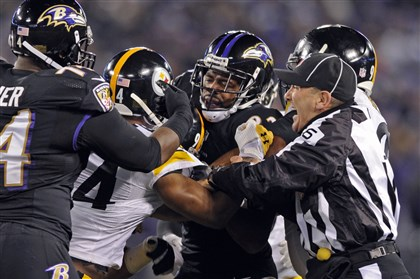1128mhSteelersVsRavensSports06-2 Referees attempt to break up a post-whistle scuffle between the Steelers and the Ravens in Baltimore.