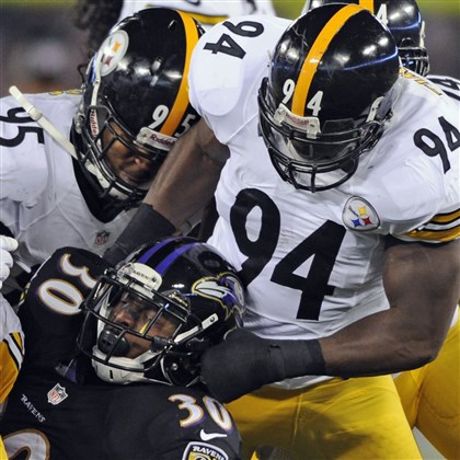 1128mhSteelersVsRavensSports10-6 Lawrence Timmons brings down the Ravens RB Bernard Pierce during the Thanksgiving game in Baltimore.