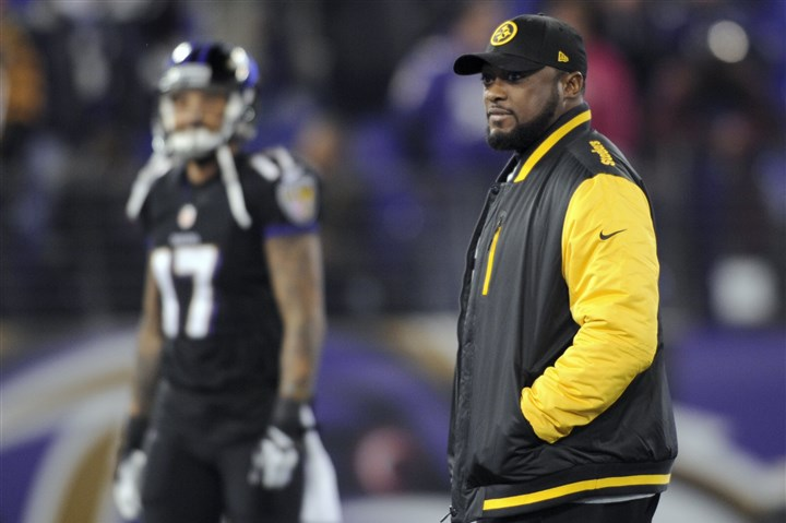 1128mhSteelersVsRavensSports03-1 Mike Tomlin walks the field while the Steelers warm up before facing off at M&T Bank Stadium in Baltimore Thanksgiving evening.